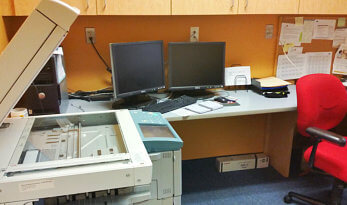 computers, chair and copier machine